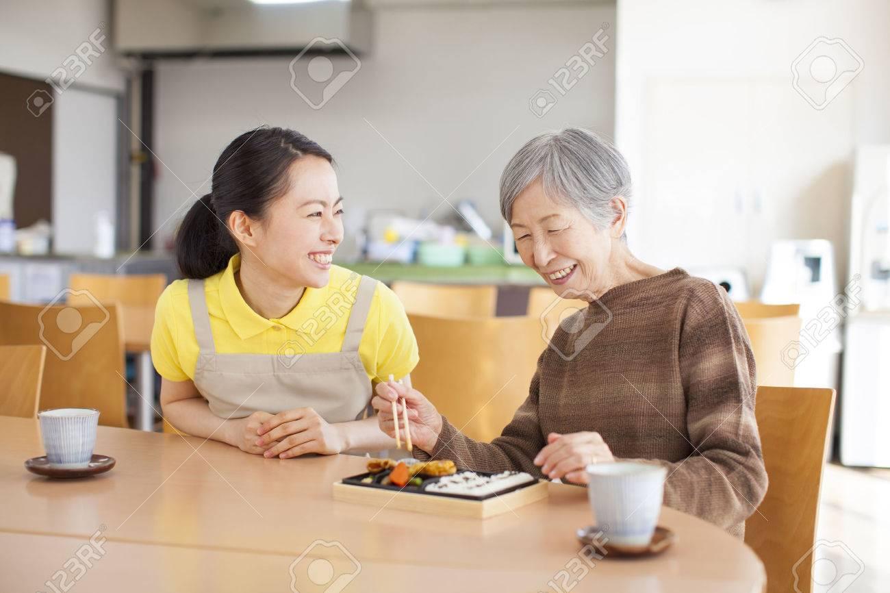 Granny eats lunch - 50330320