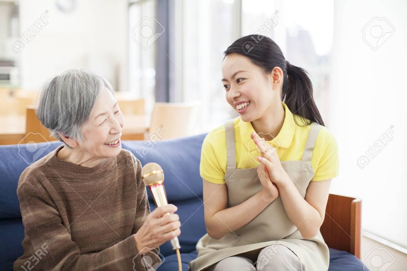 Granny enjoying the karaoke - 50331557