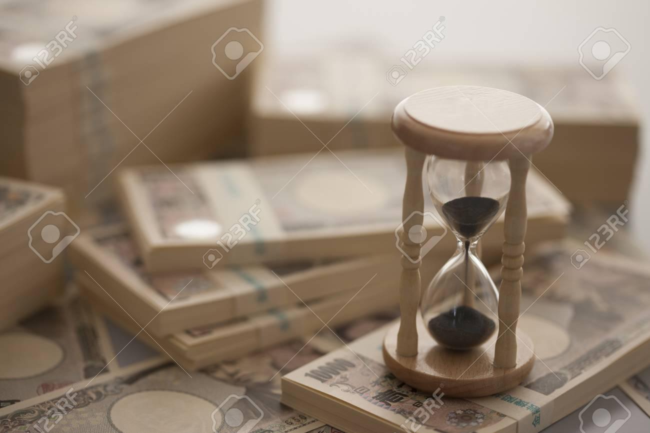 Money and hourglass - 50494436