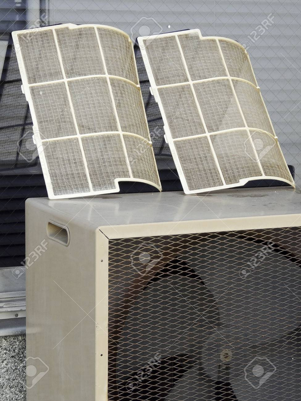 cleaning of air conditioning filters for home stock photo, picture