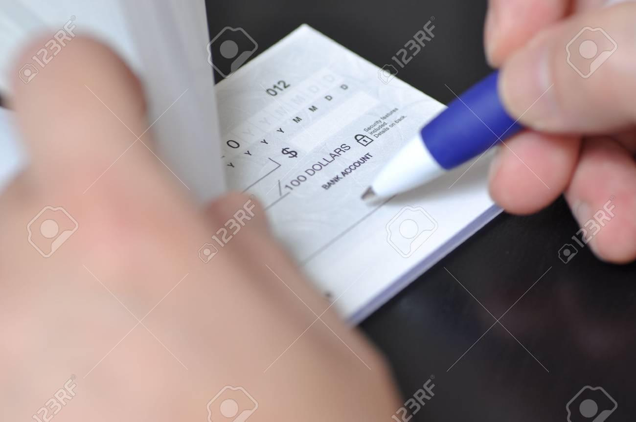 Man hold a pen to write check Stock Photo - 10944503