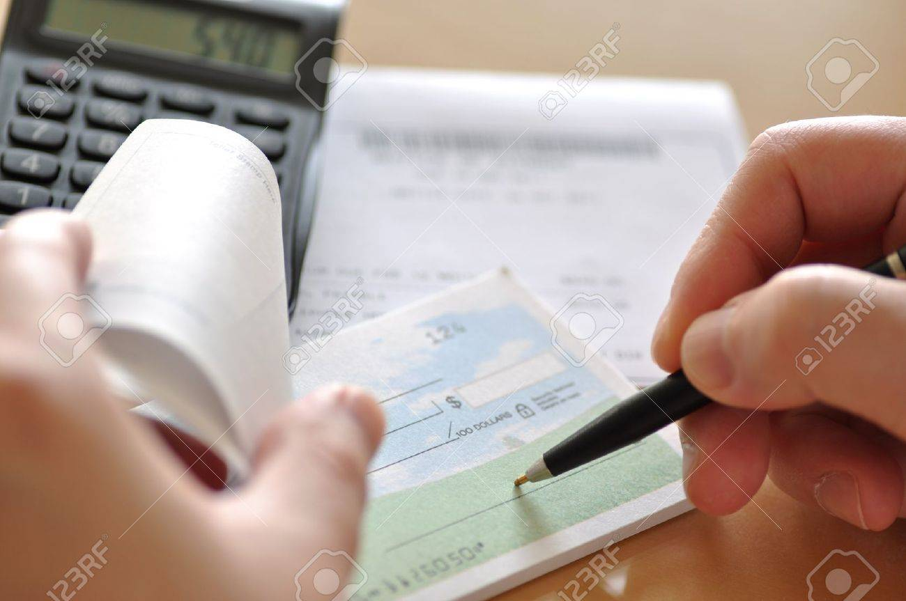 prepare writing a check to pay bill stock photo picture and prepare writing a check to pay bill stock photo 11194872