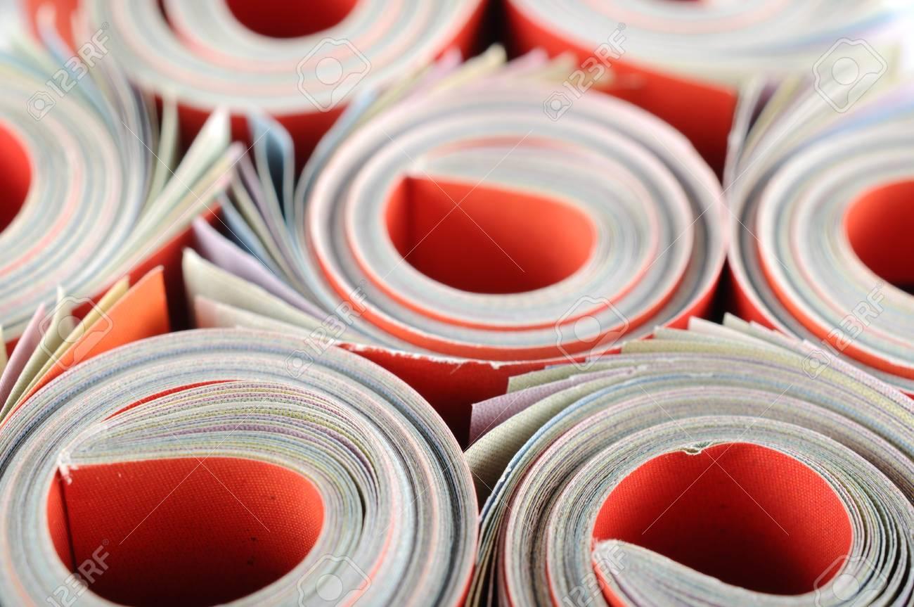 Rolled magazine background Stock Photo - 16959729