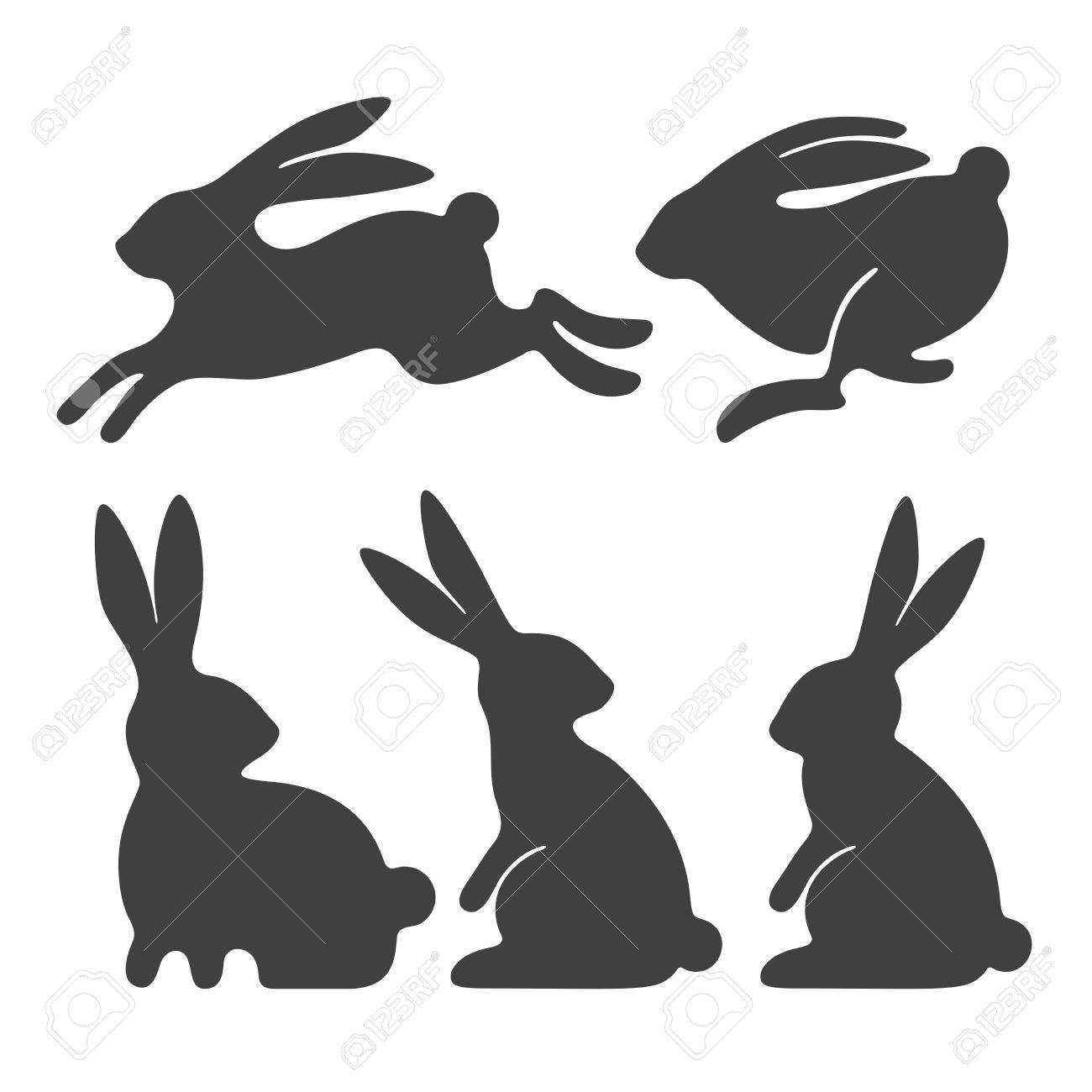 Stylized silhouettes of sitting and running rabbits - 85124086