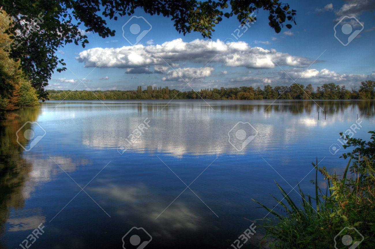 Beautiful autumnal lake in sunny day in HDR. Stock Photo - 7883246
