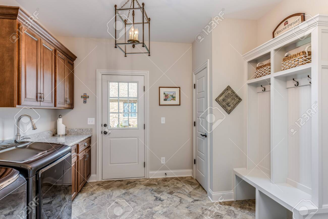 Combination Of Mudroom And Laundry Room With Door To Exterior Stock Photo Picture And Royalty Free Image Image 146181384