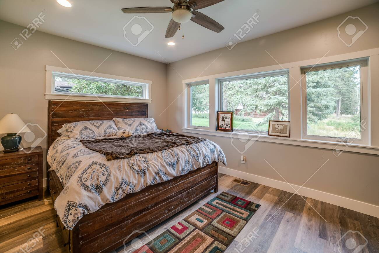 Good Size Master Bedroom With Hardwood Floors And Linear Window Stock Photo Picture And Royalty Free Image Image 146421261