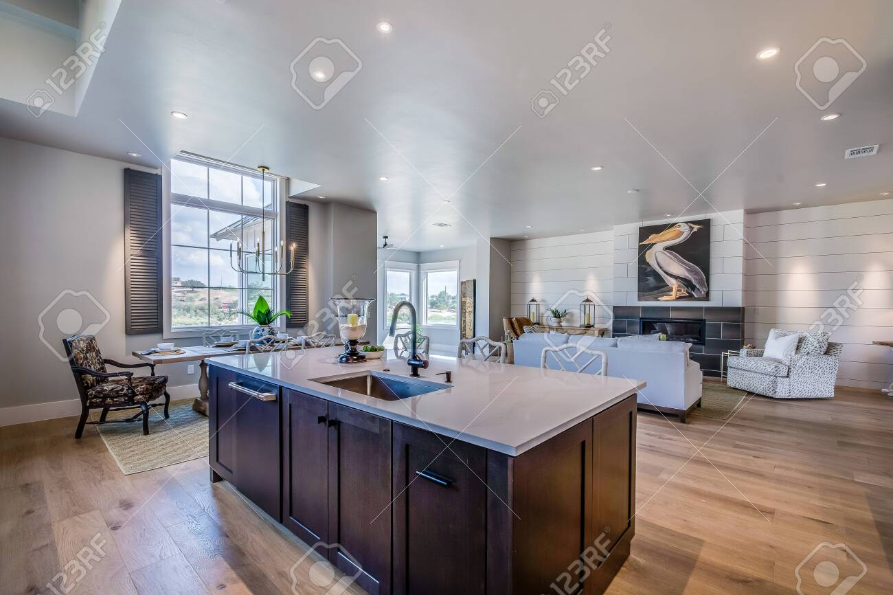Open Concept Kitchen With Large Island And Dining Area Nearby ...