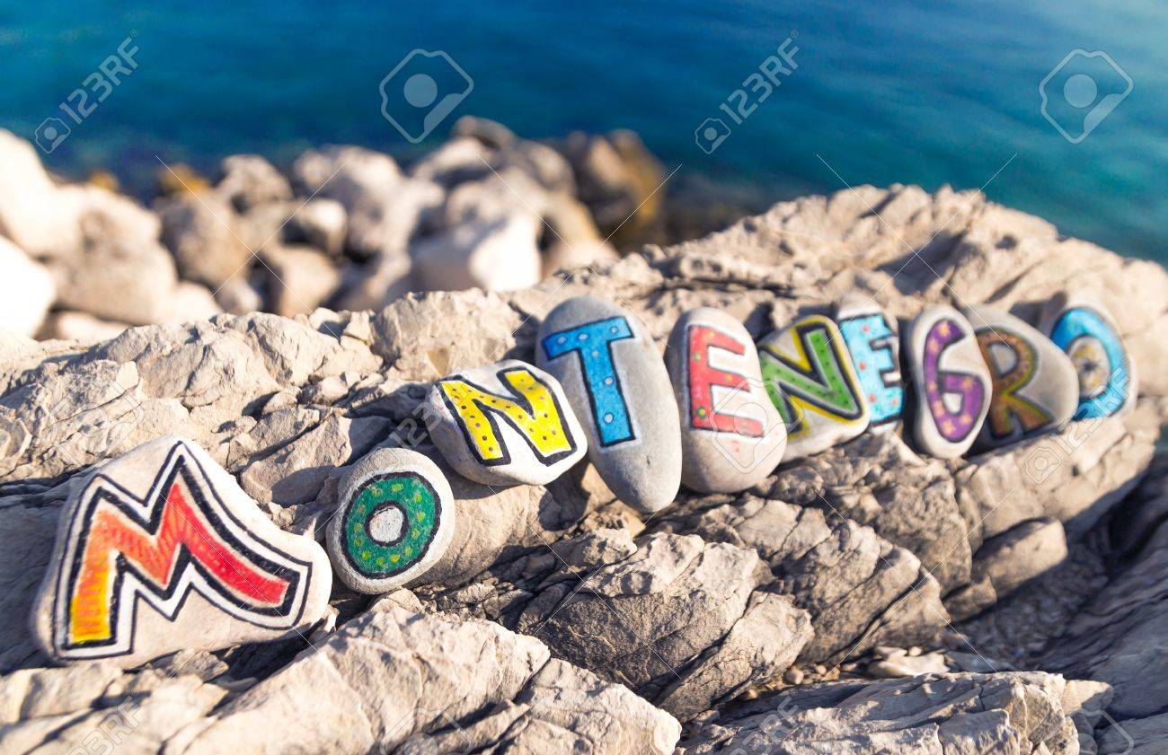 Montenegro Name Made Of Colorful Painted Stones On Sea Background ...