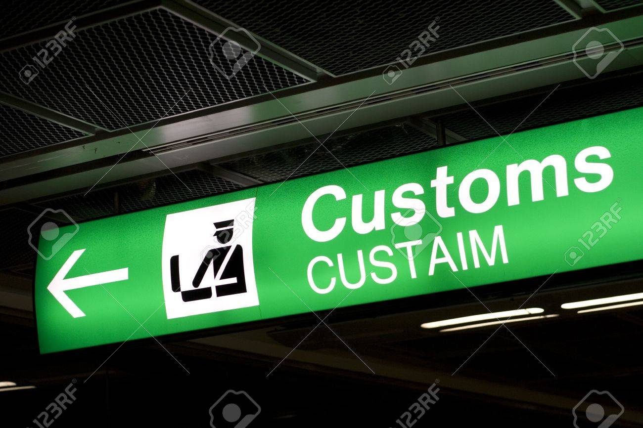 Customs sign in Airport and direction arrow, green and lighted. Stock Photo - 4118911