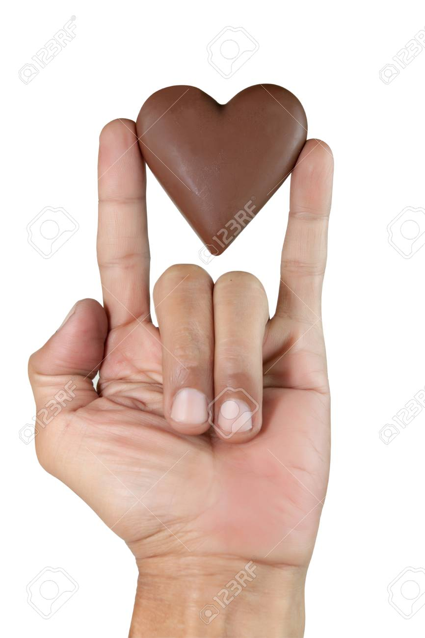 Male hand showing sign language means that i love you and male hand showing sign language means that i love you and chocolate heart shape isolated buycottarizona Choice Image