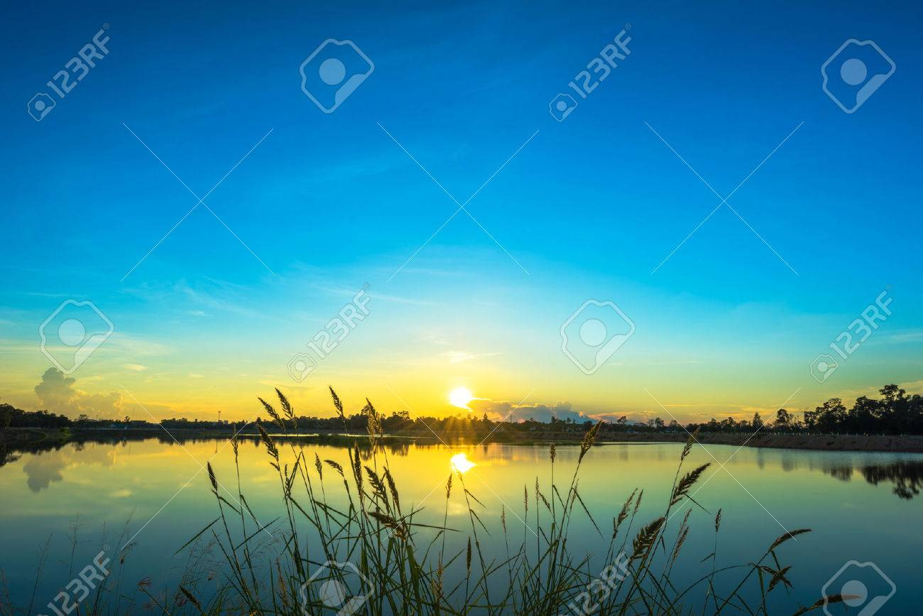 Sunset landscape with blue sky at the calm lake - 43848961