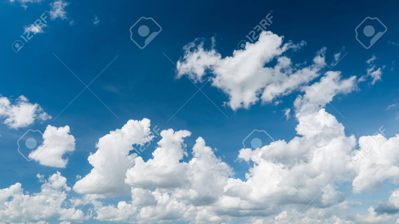 wonderful white cumulus clouds on blue sky ロイヤリティーフリー