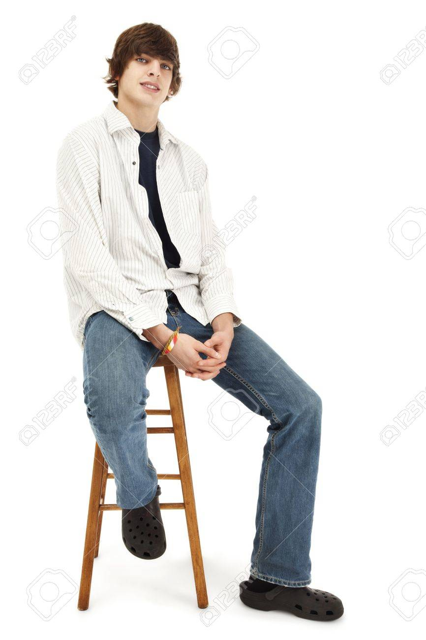 Amazing Photo Of A Casual Young Man Sitting On A Wooden Stool Ocoug Best Dining Table And Chair Ideas Images Ocougorg