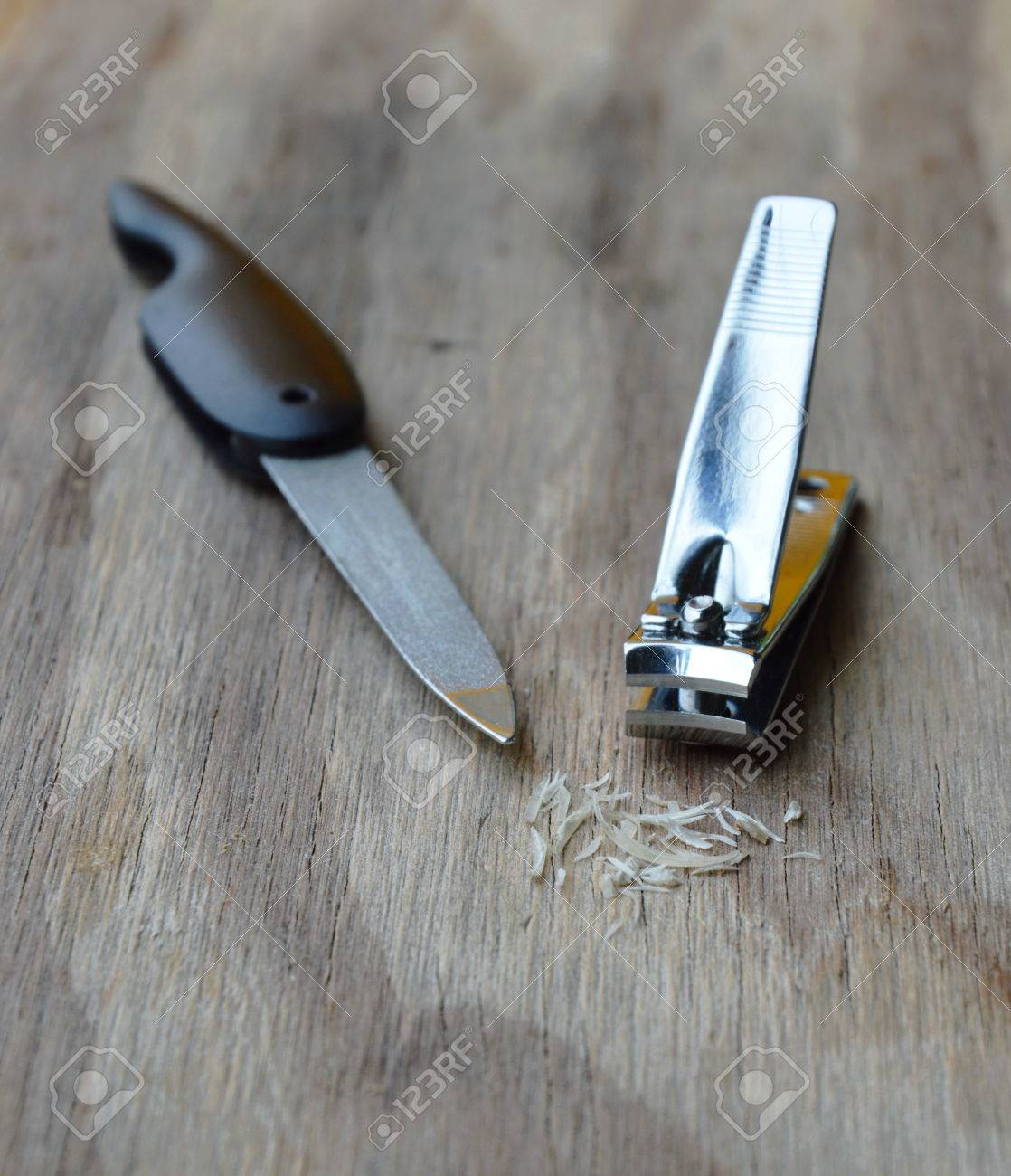 Nail Clipper And Emery File On Wooden Board Stock Photo, Picture And ...