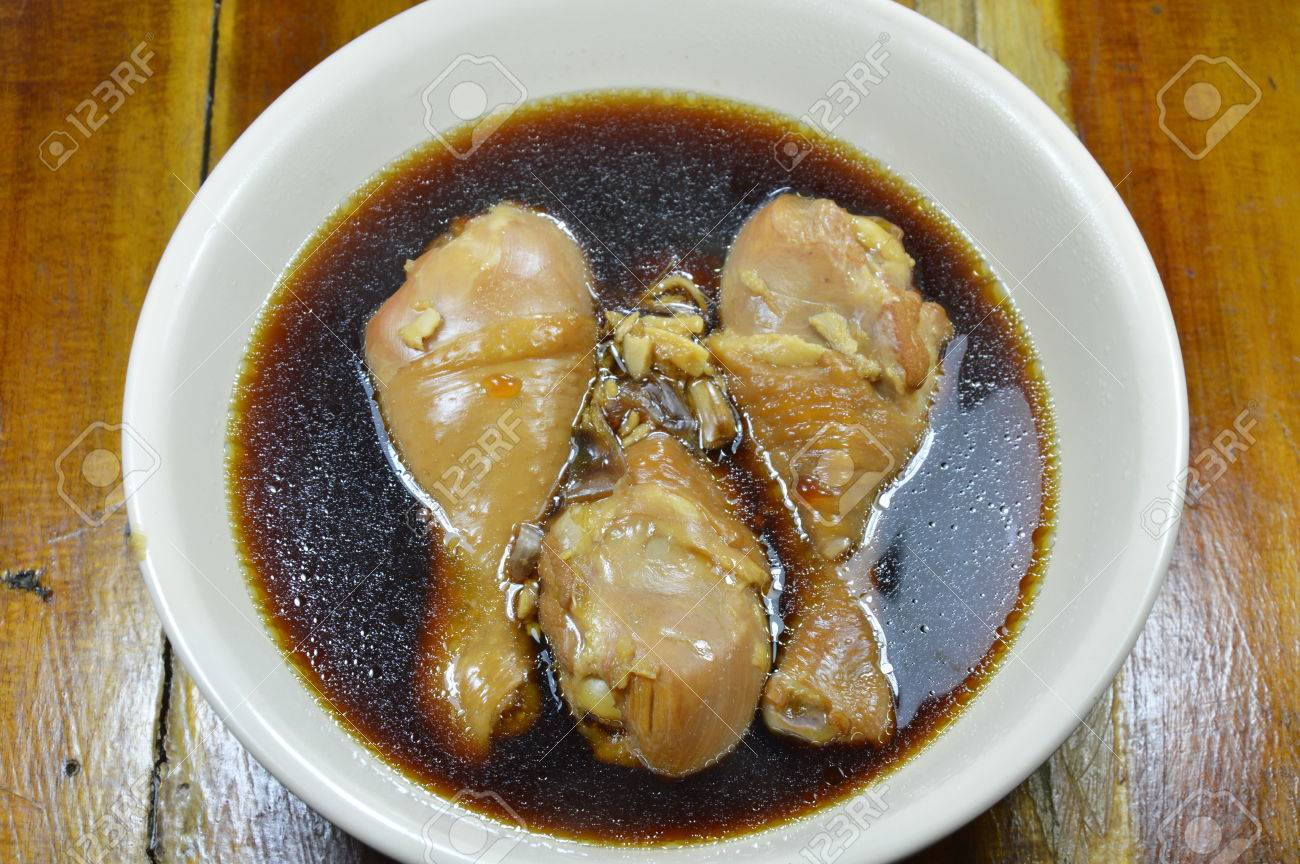Stock Photo  Boiled Chicken Leg In Fish Sauce And Chinese Herb Brown Soup
