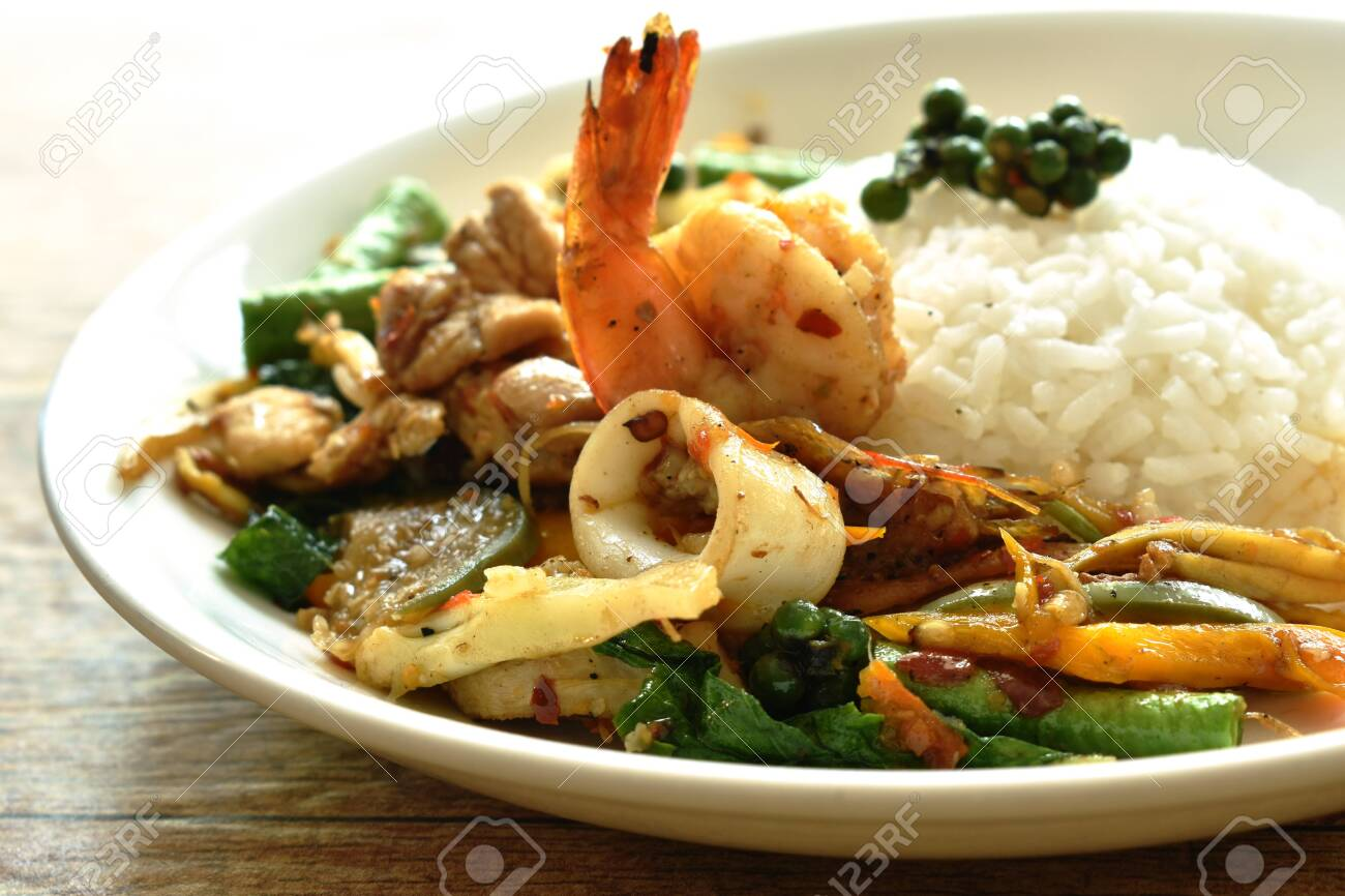 spicy stir fried seafood and meat with chili on rice - 135593854