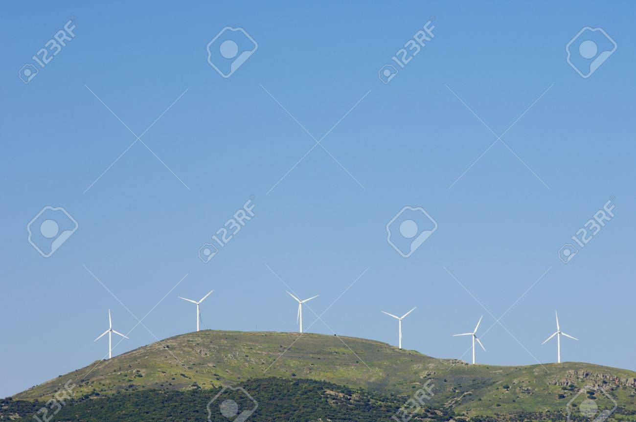 Aligned windmills in a hill - 6181361