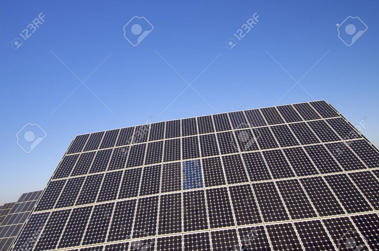 photovoltaic panel and blue sky with little moon Stock Photo - 6335113