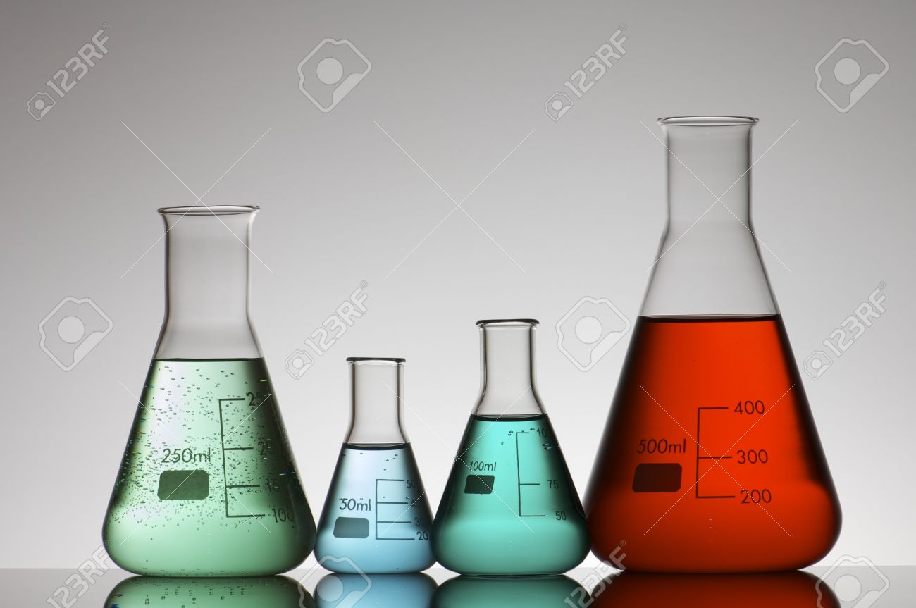 four conical glass flasks in a chemistry lab Stock Photo - 7717657