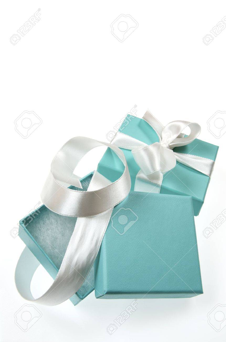 two small turquoise box tied with a white ribbon - 33537013