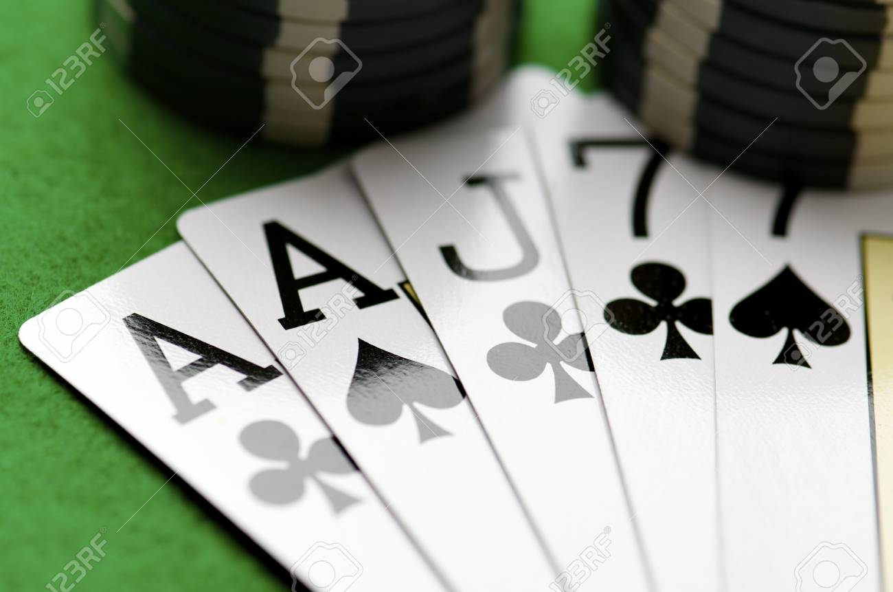 cards and gambling chips  stacked on a table Stock Photo - 10558135