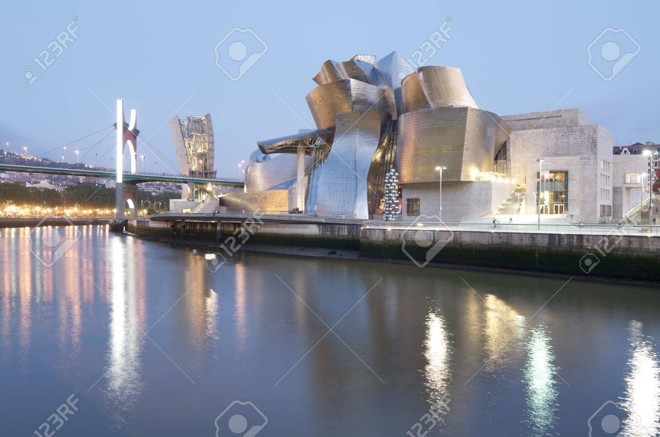 Bilbao, Biscay, Basque Country, Spain, July 30, 2011: night view of the  Guggenheim Museum and Nervion river at sunset. Guggenheim Museum is dedicated  exhibition of modern art and was  designed by architect Frank Gehry. Stock Photo - 11063602