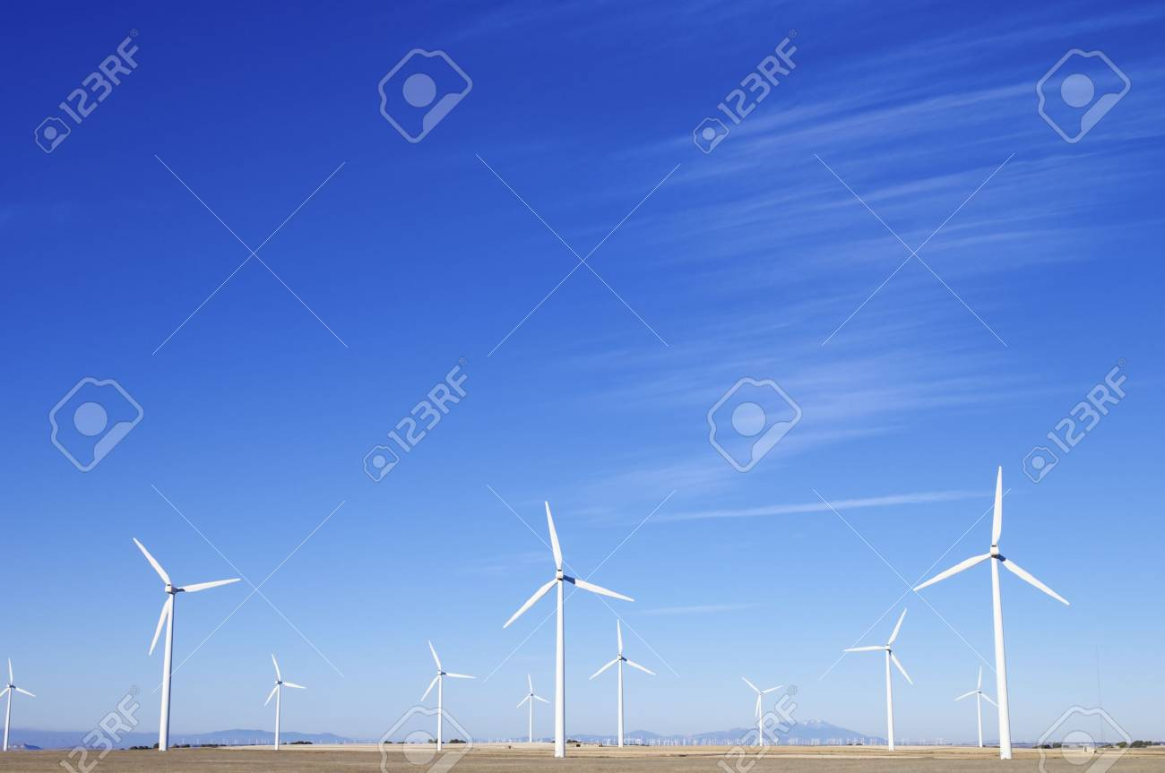 group of aligned windmills for electric power generation alternative Stock Photo - 11378624