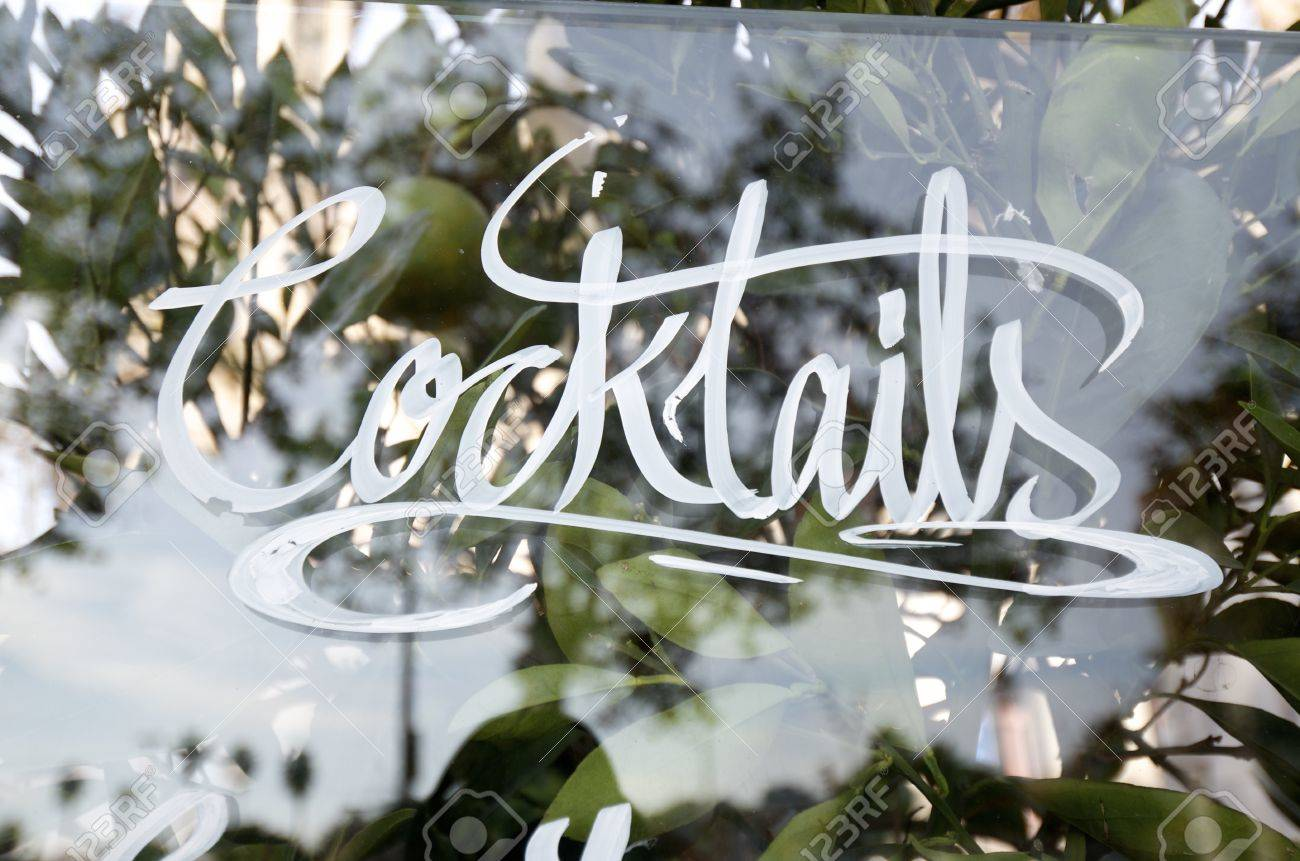 written  on the glass cocktails  in a bar Stock Photo - 11721710