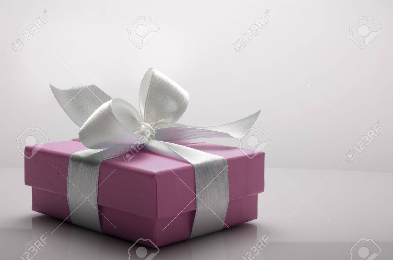 small pink box tied with a white ribbon - 12287950