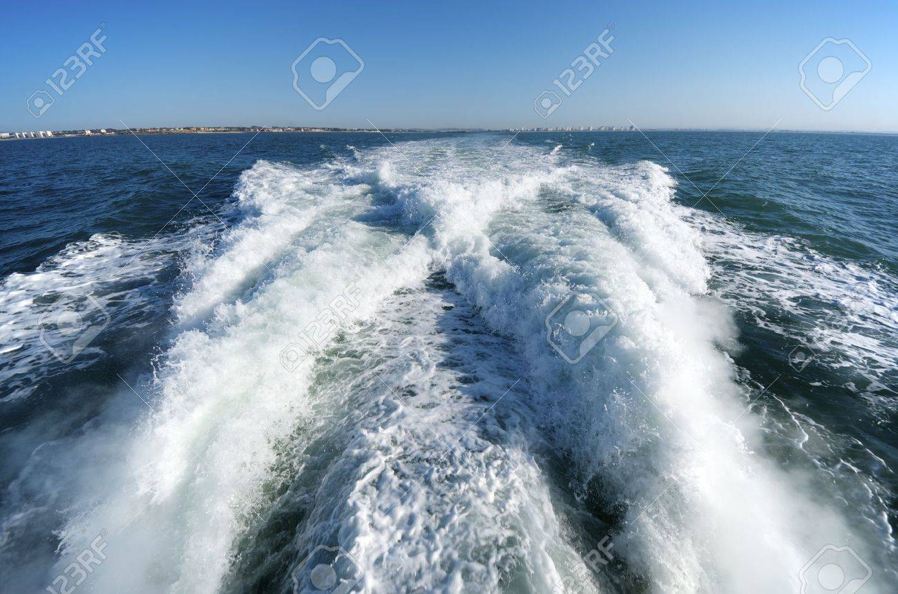 wake of a passenger ship in a clear sky day - 12287932