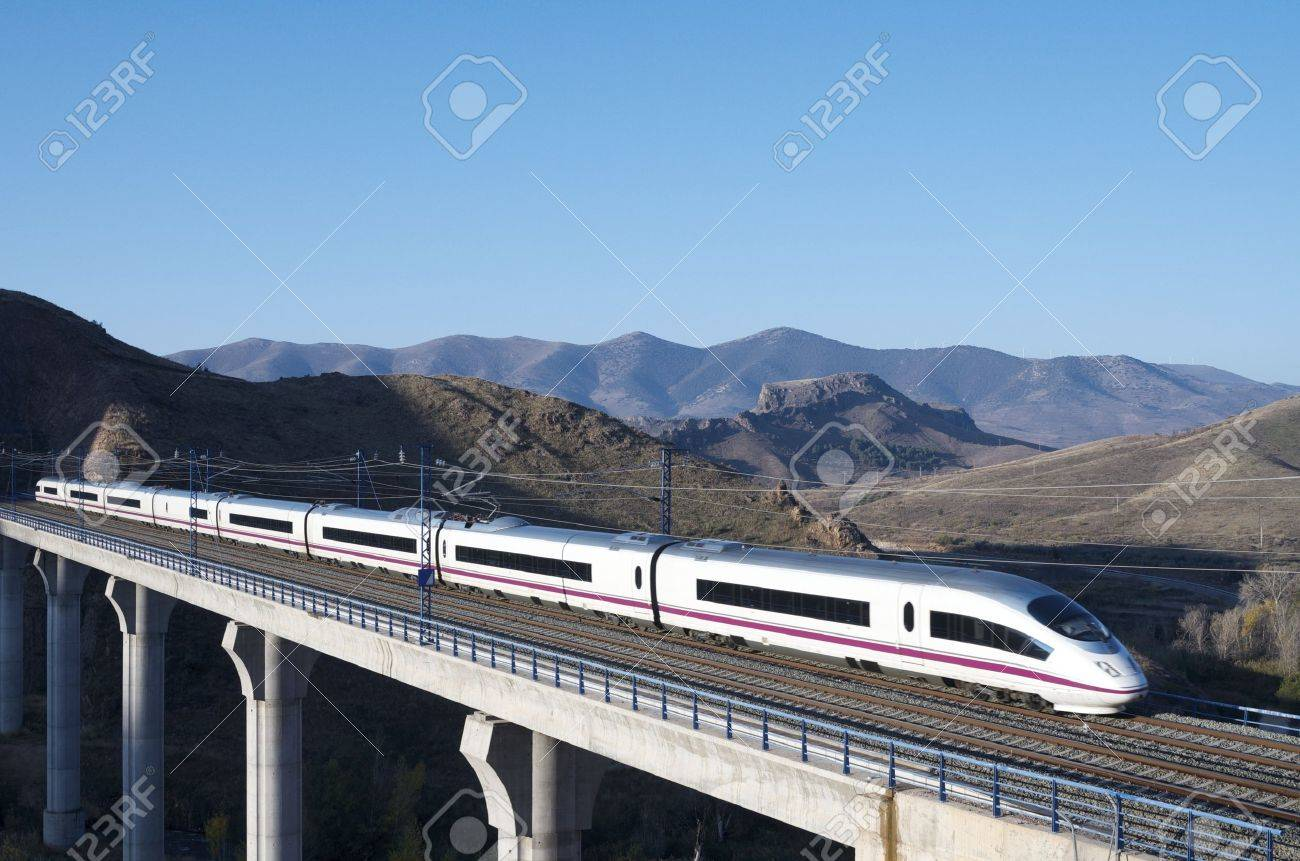 view of a high-speed train crossing a viaduct in Purroy, Saragossa, Aragon, Spain; AVE Madrid Barcelona - 12680499