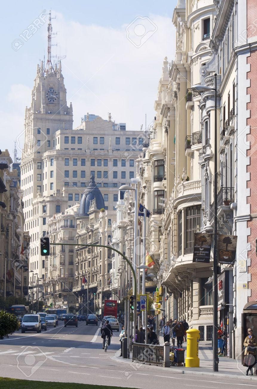 Madrid, Spain - February 22, 2012: A view of the street known as Gran Via, one of the busiest streets of the city and traveled daily by thousands of tourists - 12992946