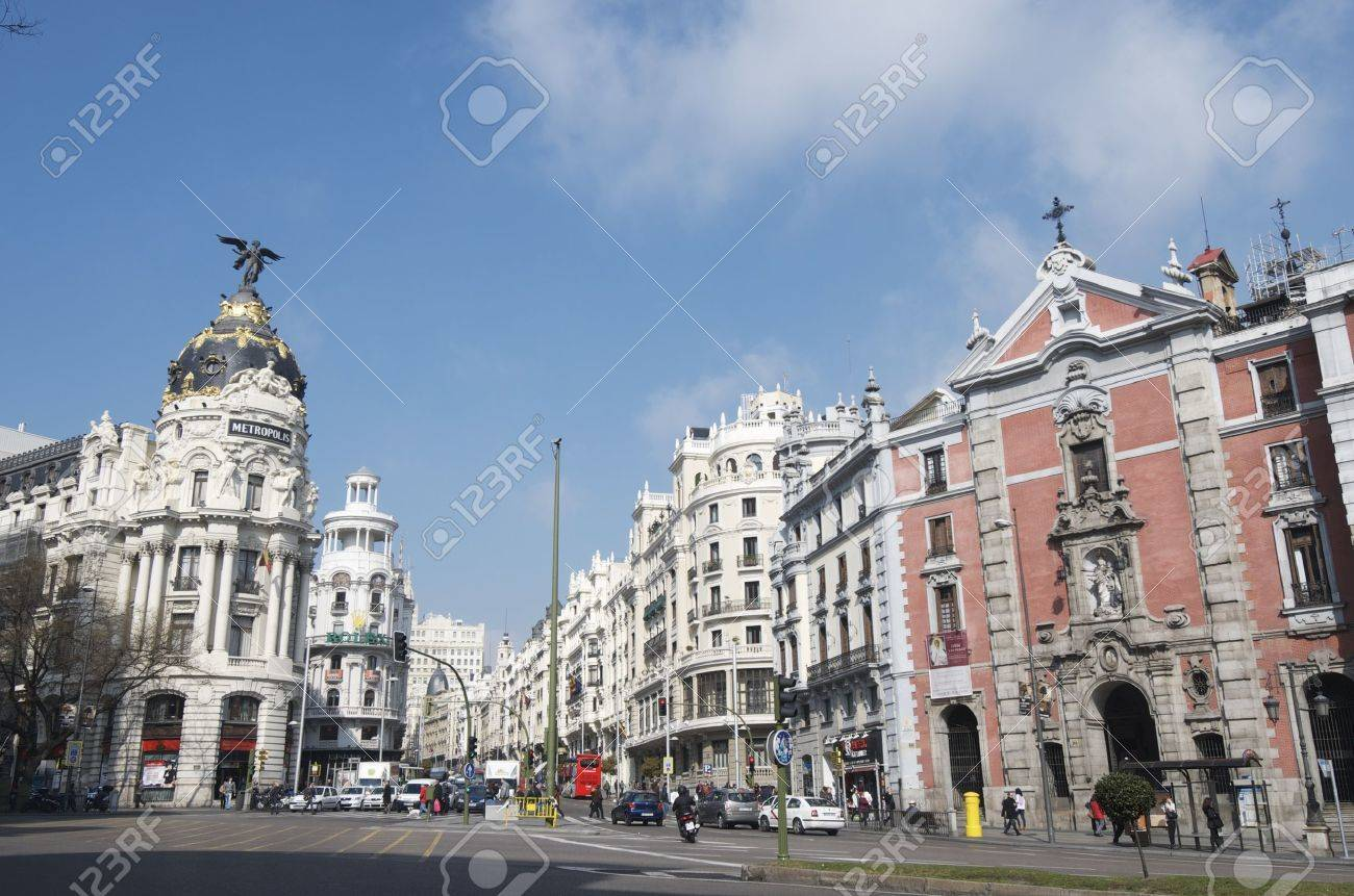 Madrid, Spain - March 22, 2012: A view of the street known as Gran Via, one of the busiest streets of the city and traveled daily by thousands of tourists. From the buildings stands the building known as Metropolis - 14597283