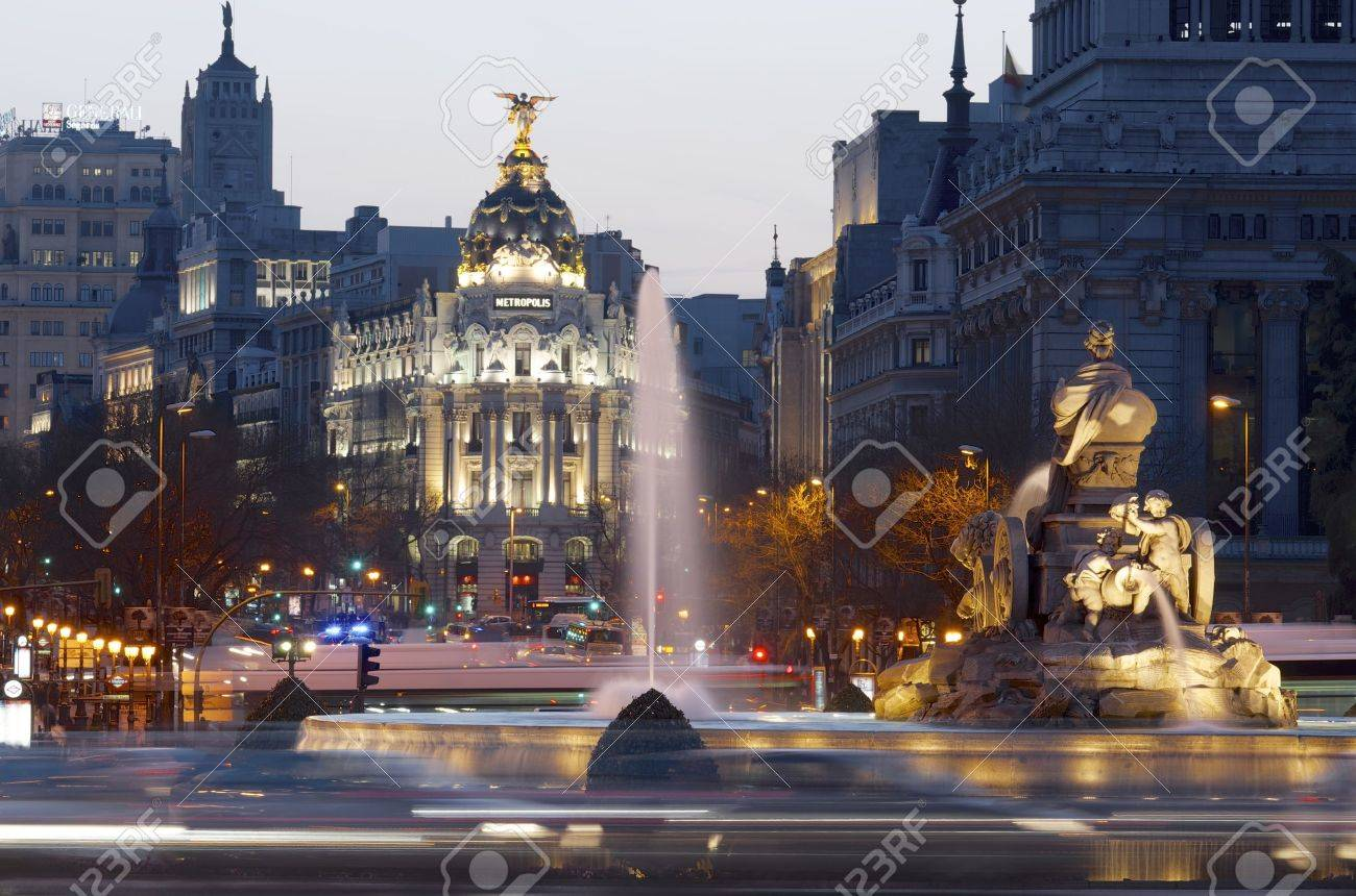 Madrid, Spain - March 22, 2012: heavy traffic in the historic center of Madrid, highlights the Metropolis building and the Cibeles fountain, two of the most visited monuments in the city. - 14597281