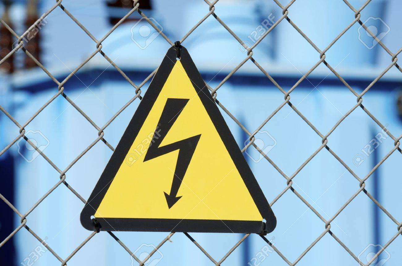 electrical hazard sign placed on a metal fence Stock Photo - 16702993