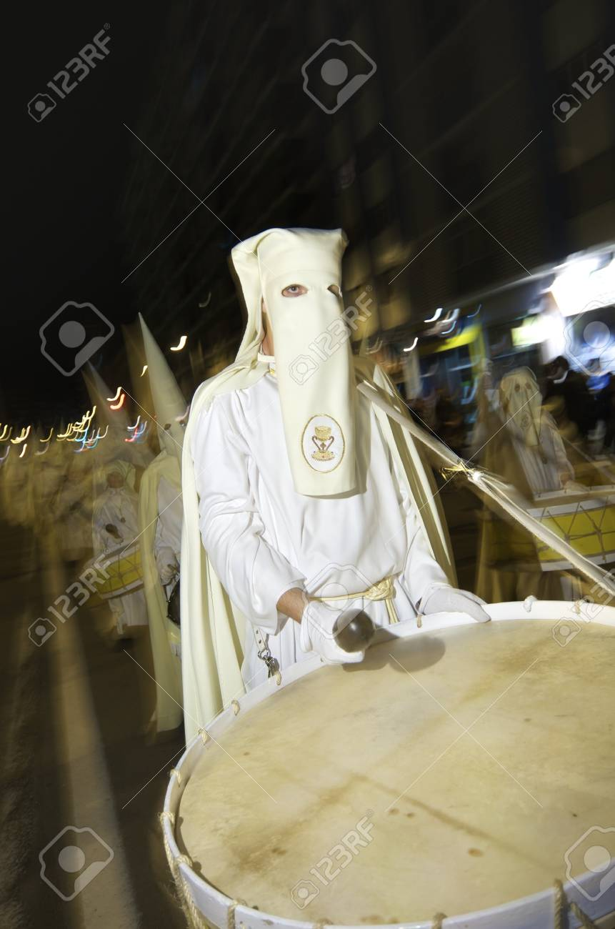Saragossa, Spain - April 19, 2004: Procession during Holy Week in Saragossa. Brotherhood of the Holy Eucharist of the Church of Perpetual Help. Holy Week has a great tradition and is one of the most important celebrations of the year Stock Photo - 16979560