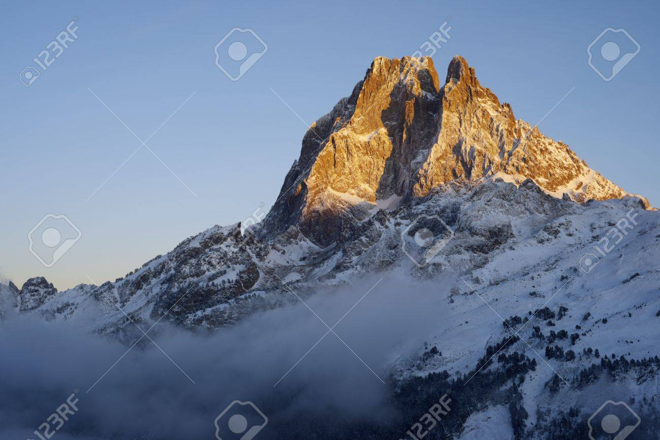 sunset on the western slope of the peak Midi d'Ossau, 2884 meters, Ossau Valley, Pyrenees, France Stock Photo - 17707201