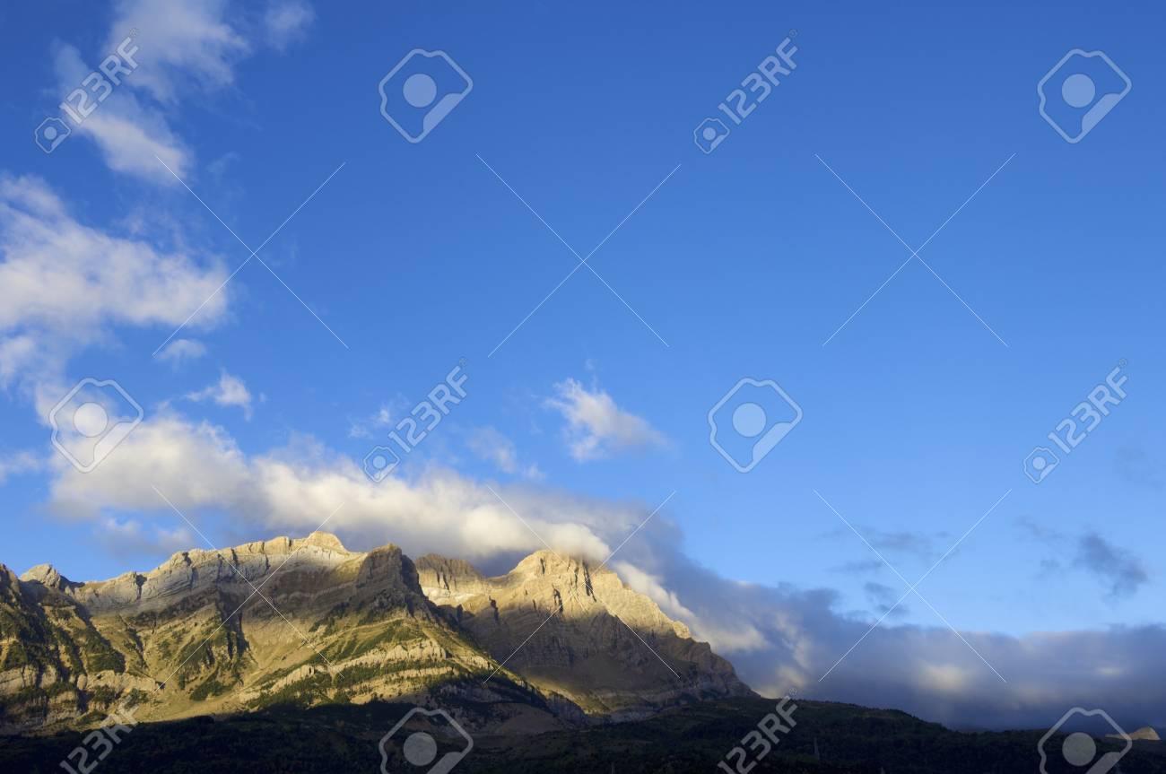 telera peak shrouded by clouds of dawn, Tena Valley, Pyrenees, Huesca, Spain Stock Photo - 18009300