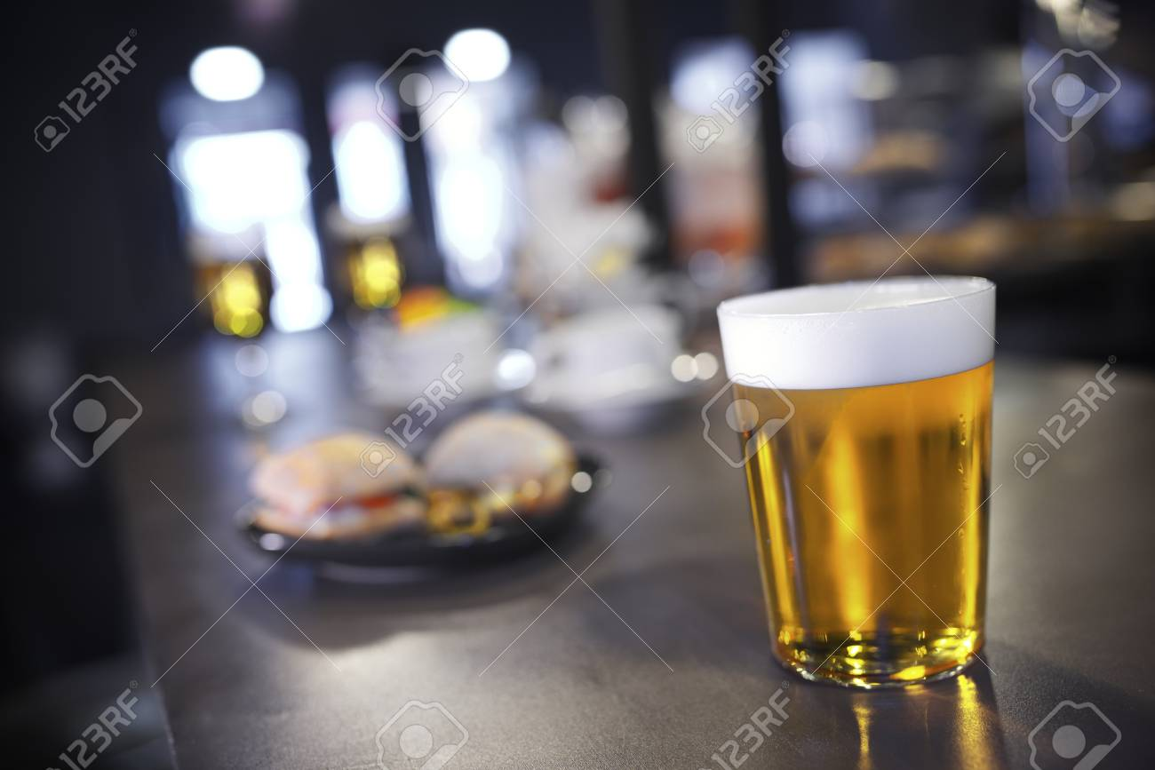 closeup of a beer glass in a bar Stock Photo - 18676983