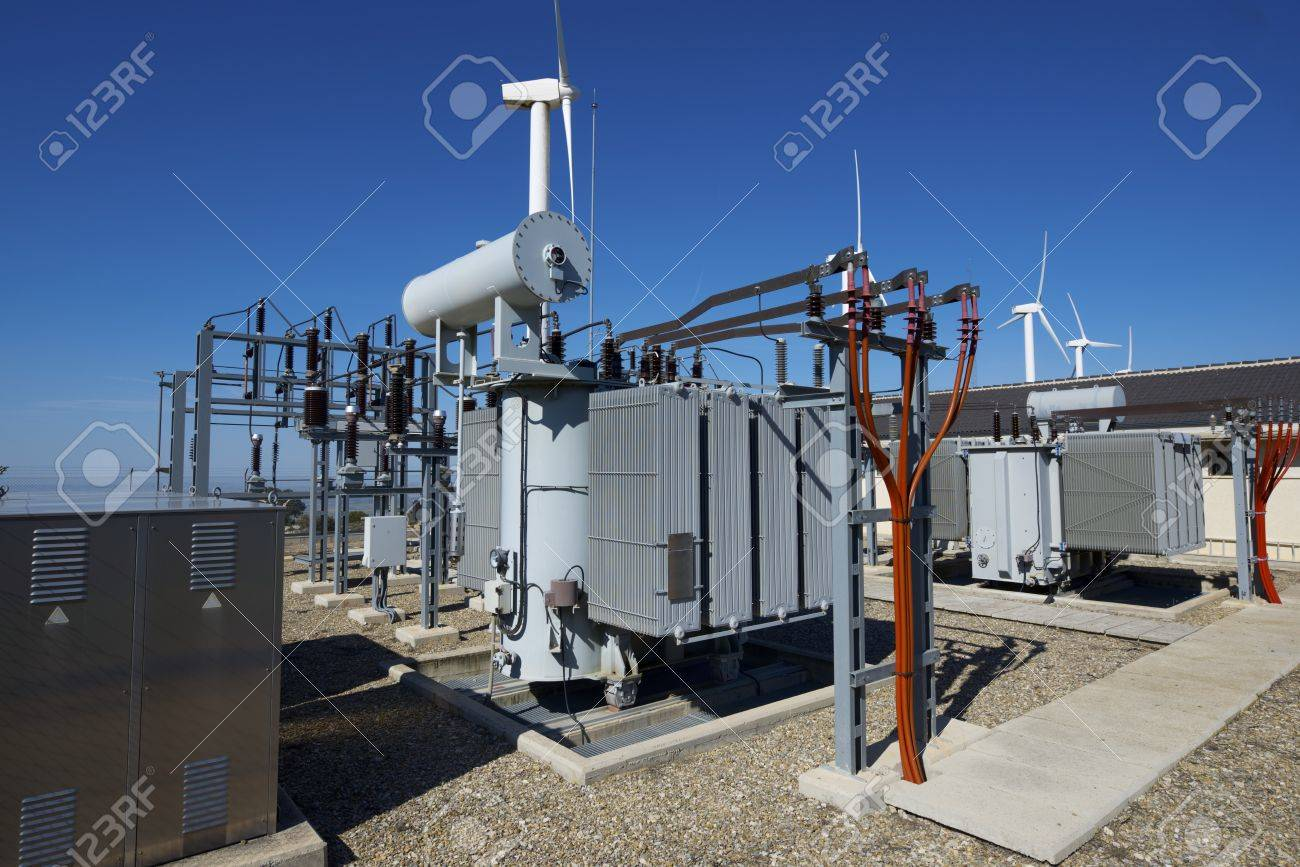 windmills for removable energy production and electrical substation, El Buste, Zaragoza, Aragon, Spain - 27696447