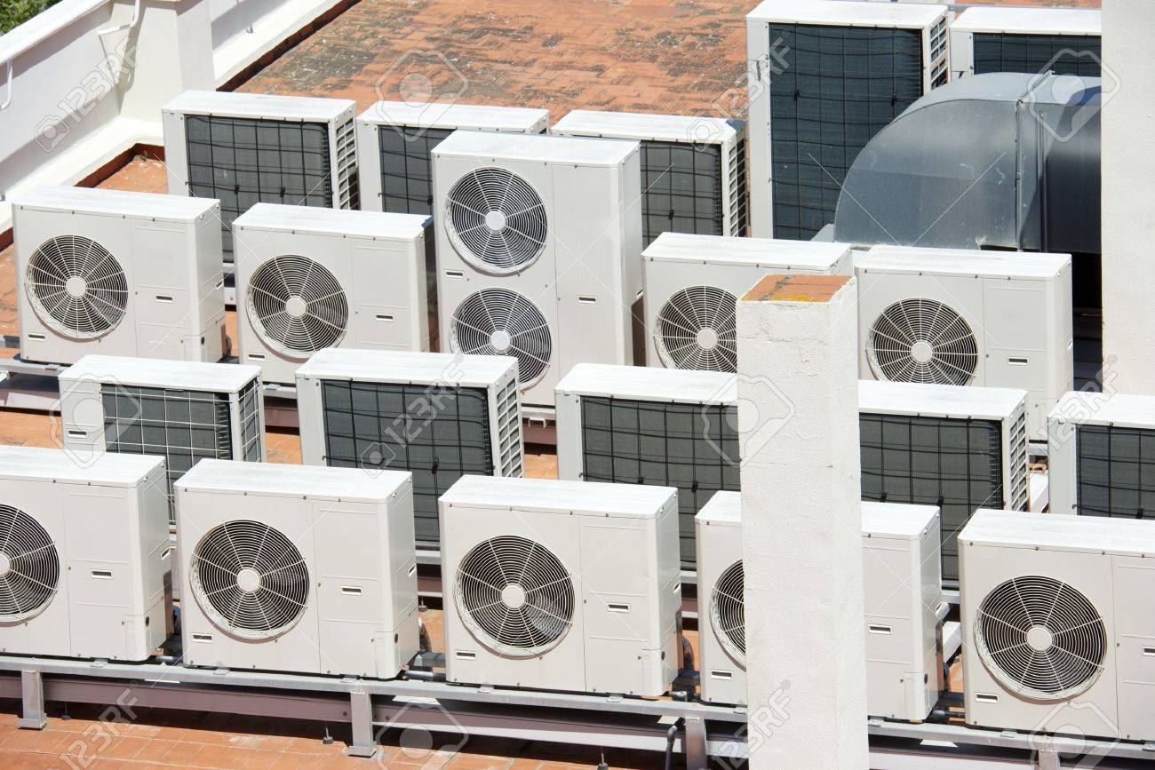 view on the roof of a building of a large air conditioning equipment - 35472673