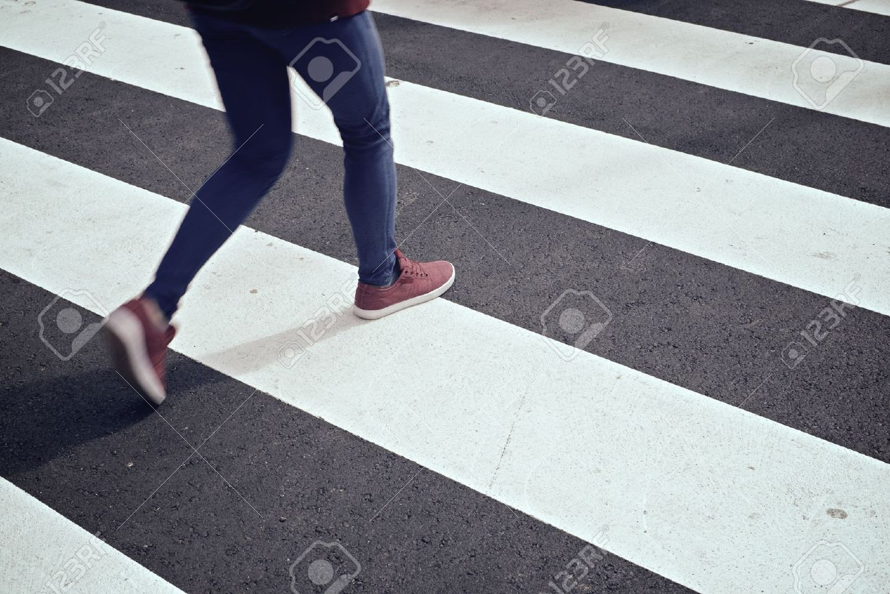Young woman crossing a zebra crossing. - 40322777