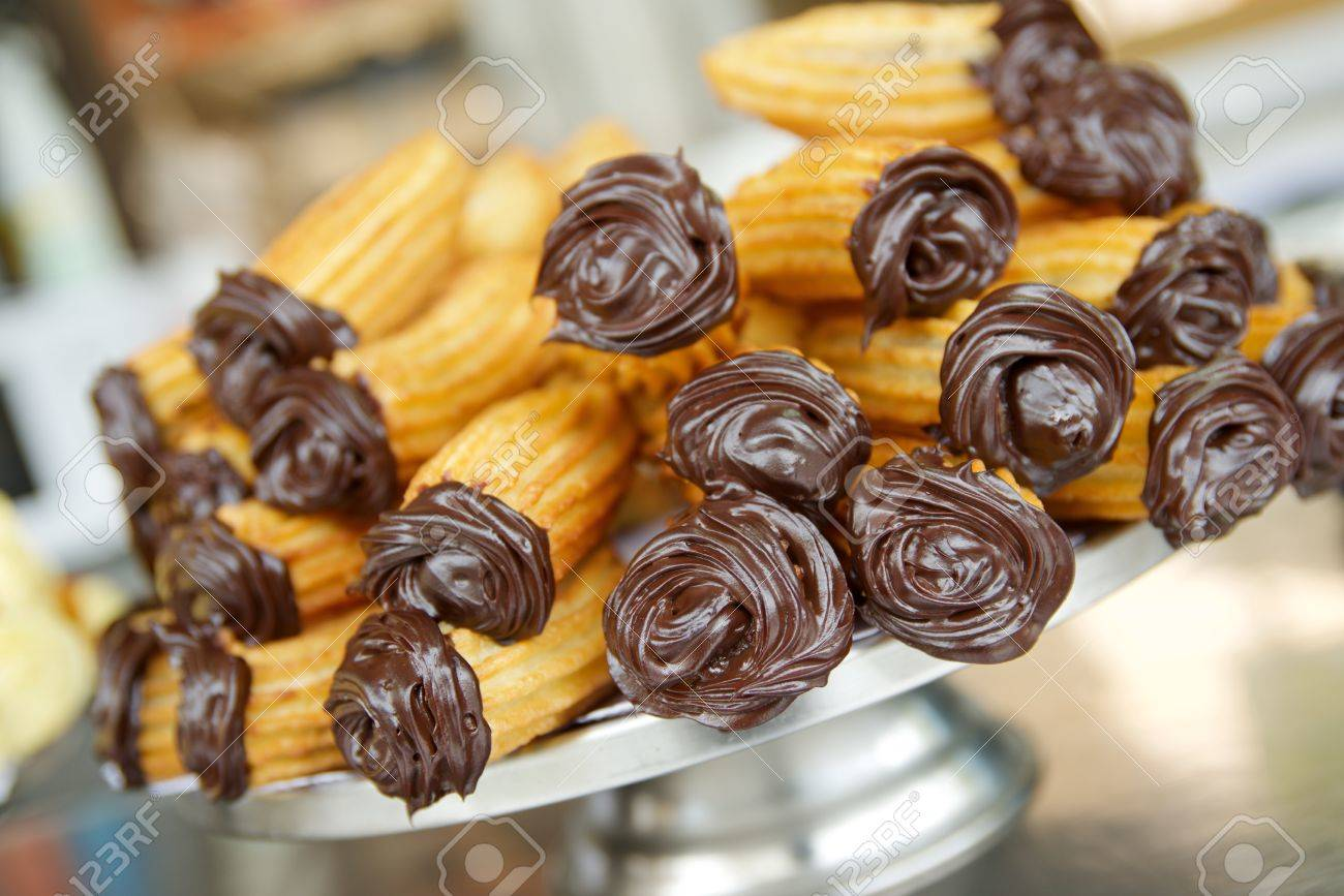 Group of typical churros at a stall, Spain. - 68625930