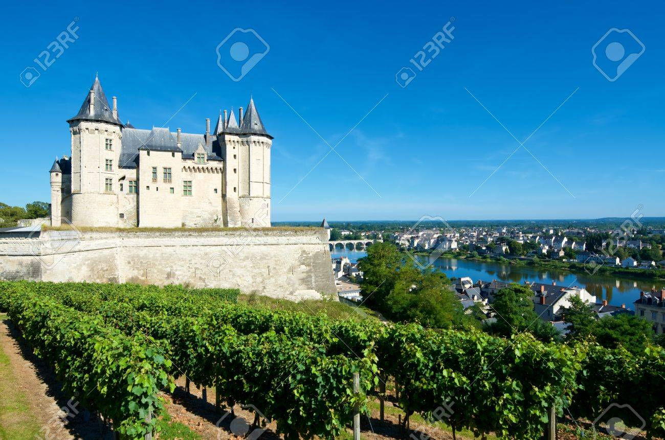 Saumur castle and Loire River, Loire Valley, France. Saumur Castle was built in the tenth century and rebuilt in the late twelfth century. It is now owned by the city and is one of the most famous castles of the Loire Valley. - 76903617