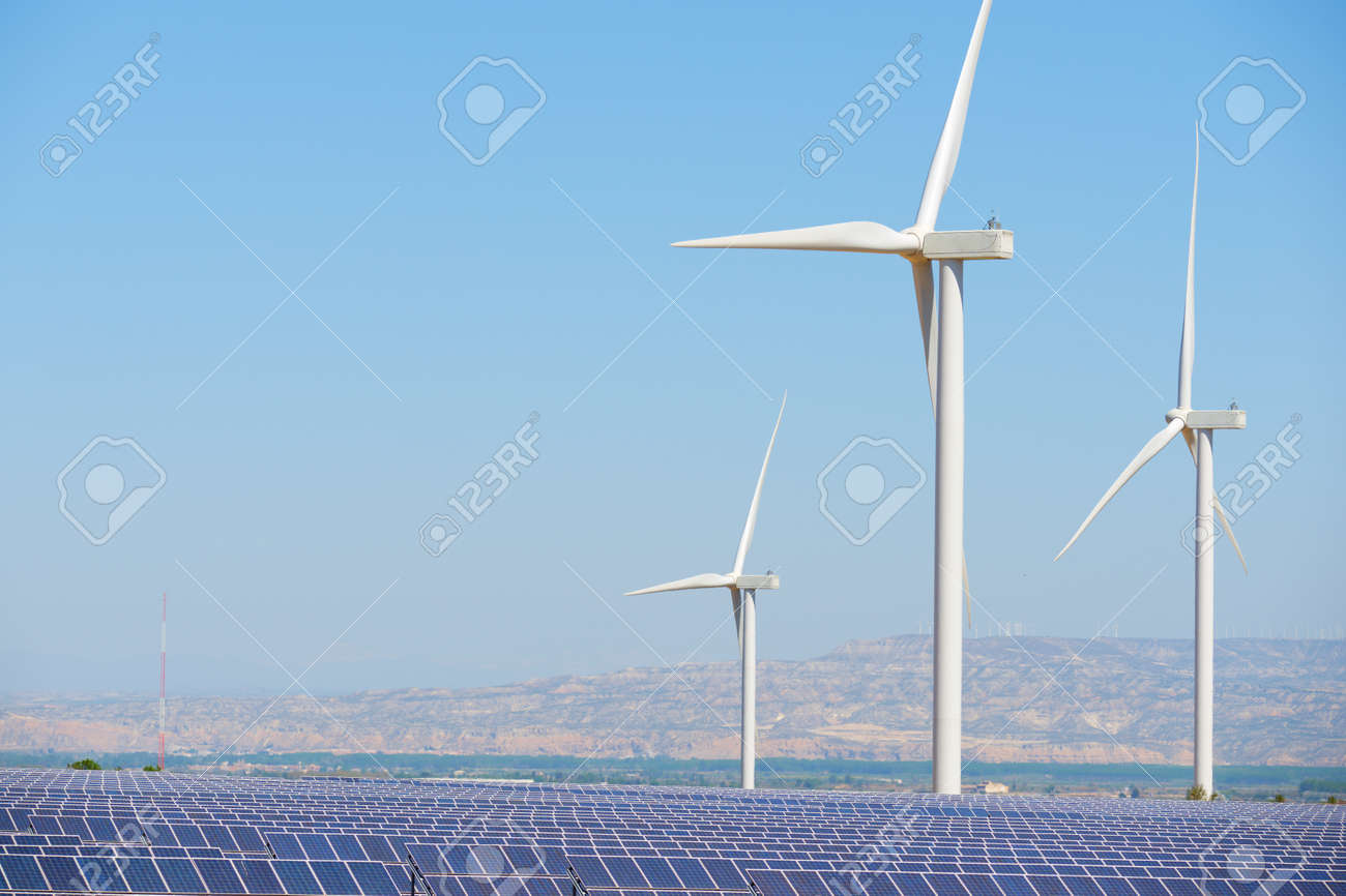 Many solar panels for electric production and windmills in Zaragoza Province, Aragon, Spain. - 168445170