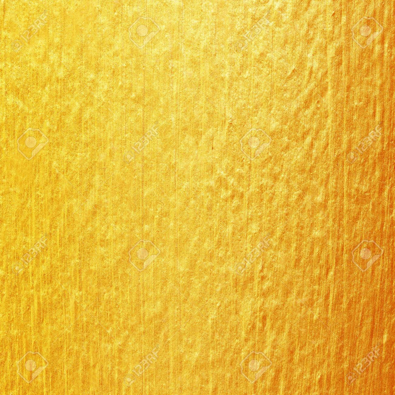 Gold Paint On Cement Wall Texture. Golden Texture Background Stock ...