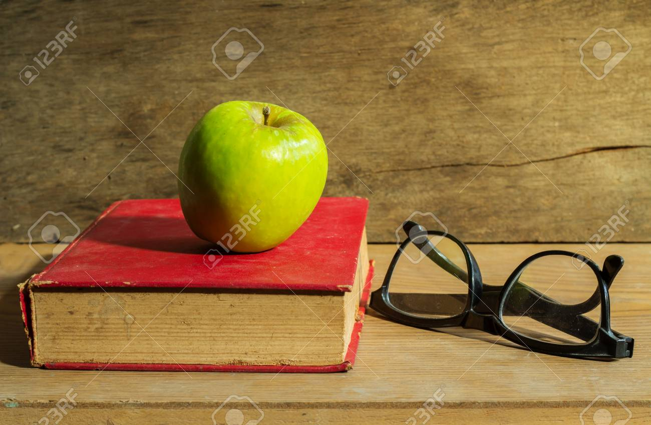 Antique book with apple Stock Photo - 22954124
