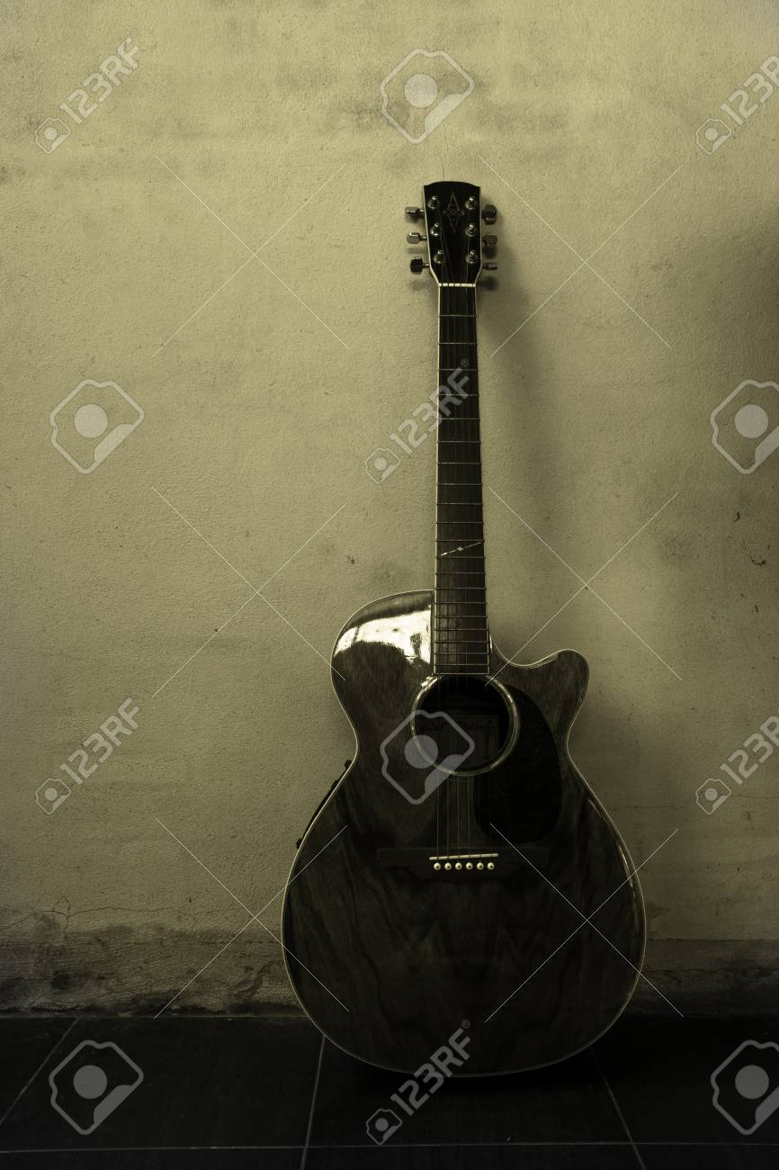 Acoustic Guitar With Grunge Texture Wall Black And White Color