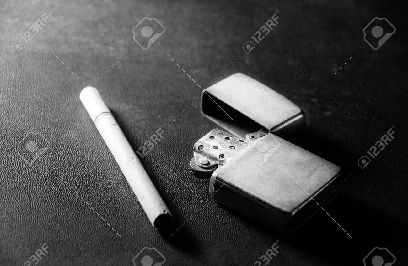 Cigarettes with old metal lighterblack and white color